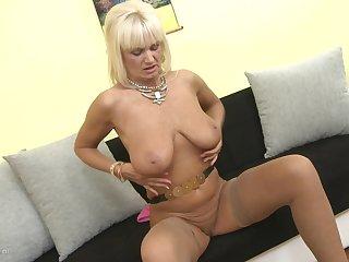 Fair-haired Euro granny Roxanna C. uses a dildo to please herself