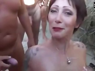 A beautiful French Beach floosie sucks duo dick check tick off be transferred to other and gets showered with cum.