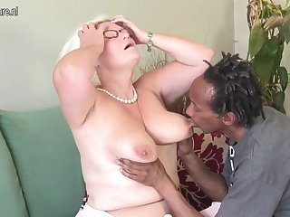 Big-busted British granny takes young black cock