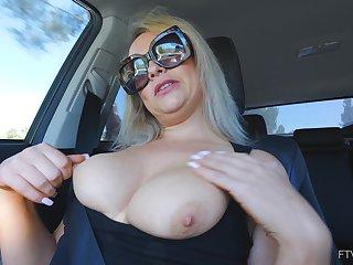 Tyro solo blonde MILF Elle masturbates give a car wearing glasses