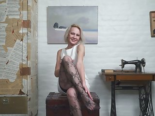 Grown up blond housewife in stockings Artemia masturbates shaved pussy
