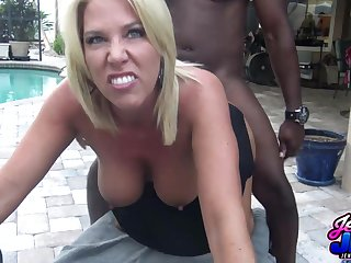 Smiley mature gets eaten out and fucked by the pool