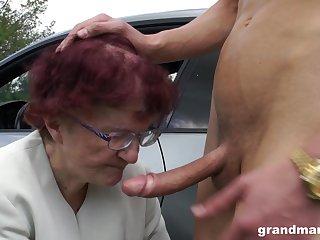 Sjort haired redhead granny gives a soaked blowjob POV nearly a car