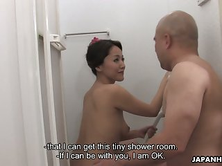 Busty Asian milf Nao Kato finger fucks pussy and gives a blowjob in the shower
