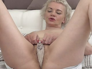 Kinky granny Rina M starts grousing while she fingers her pussy