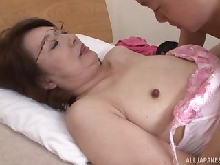 Mature Japanese in glasses stripped, fed cock and pounded missionary