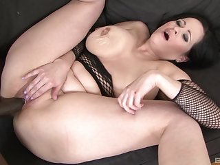 Grown-up brunette in fishnets Diana Swiet pounded by a jet dick