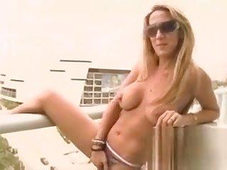 Blonde MILF with heavy tits masturbating