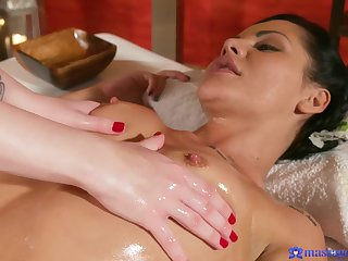 Amazing girl on girl massage therapy with a feel in one's bones fucking.