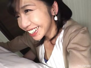 Close with respect to video of Asian babe Kikuichi Momoko giving a blowjob