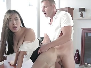 Aroused Asian MILF crowds her cunt with the man's energized monster