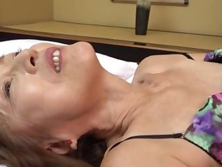 Mature Japanese Asano TAeko spreads her limbs and drills her holes