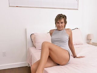 Sexy mature woman Lillian Tesh gets naked and masturbates pussy with sex toys