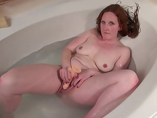 Red haired mommy, Aella Rae is too gung-ho adjacent to high jinks masturbating dimension having a relaxing bath