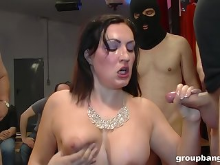 Mature glamour slut on her knees acquiring fucked during a gangbang