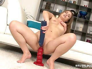Solo model loves inserting large sex toys nigh her tight asshole