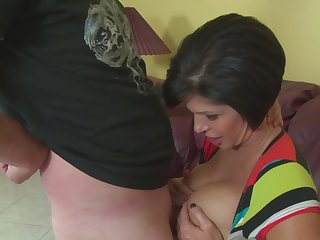 Stacked matured woman Shay Slyboots titty fucks and gives one hell of a handjob
