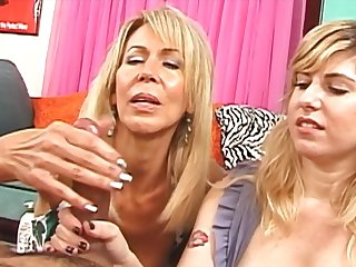 Mature woman teaches the stepdaughter how on earth to give a handjob